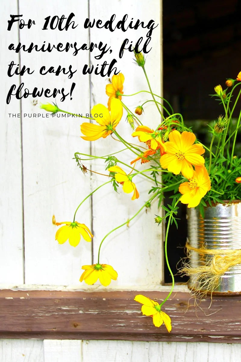 Tin can filled with yellow flowers.