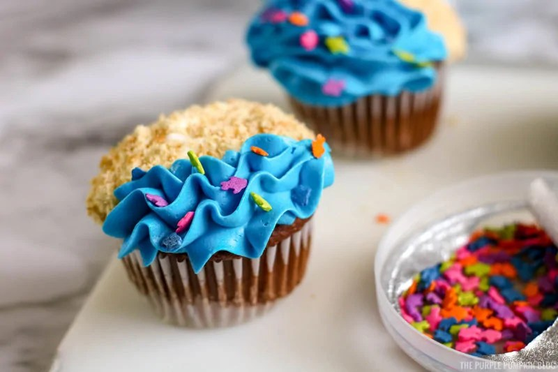 Adding Fish Shape Sprinkles to Cupcakes