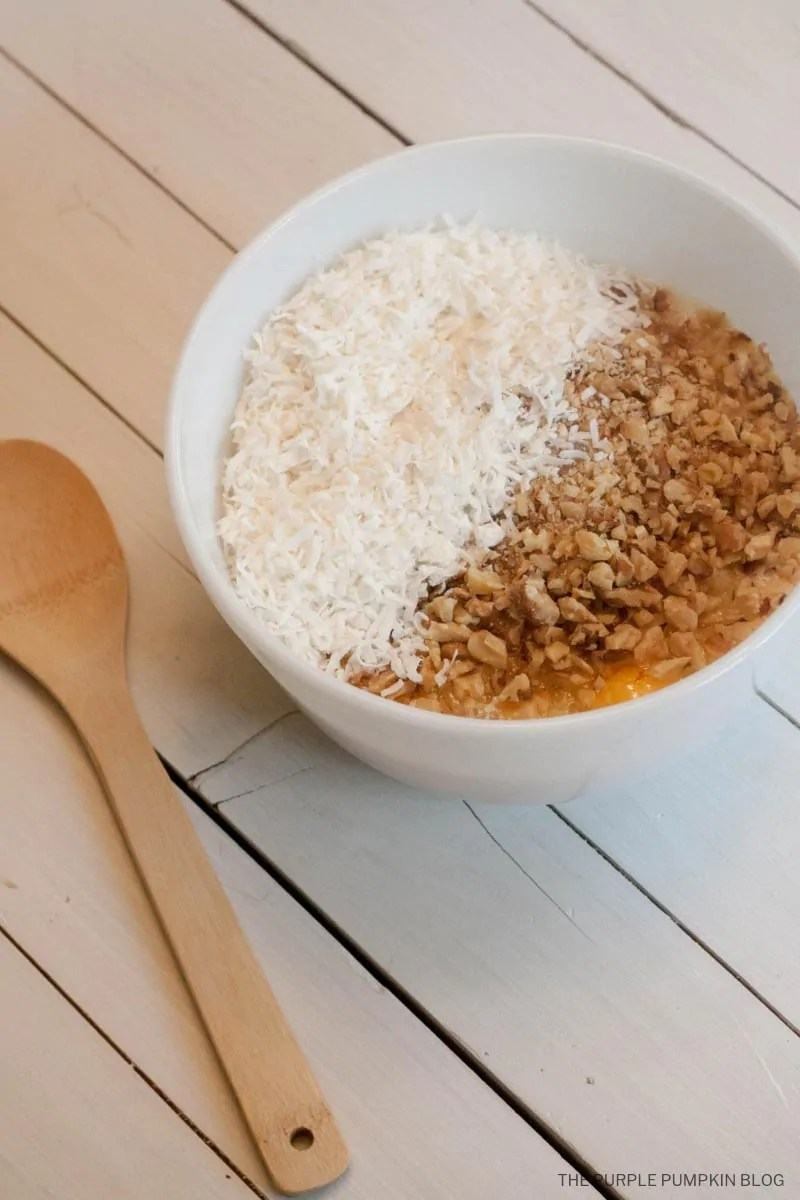 walnuts and coconut in mixing bowl