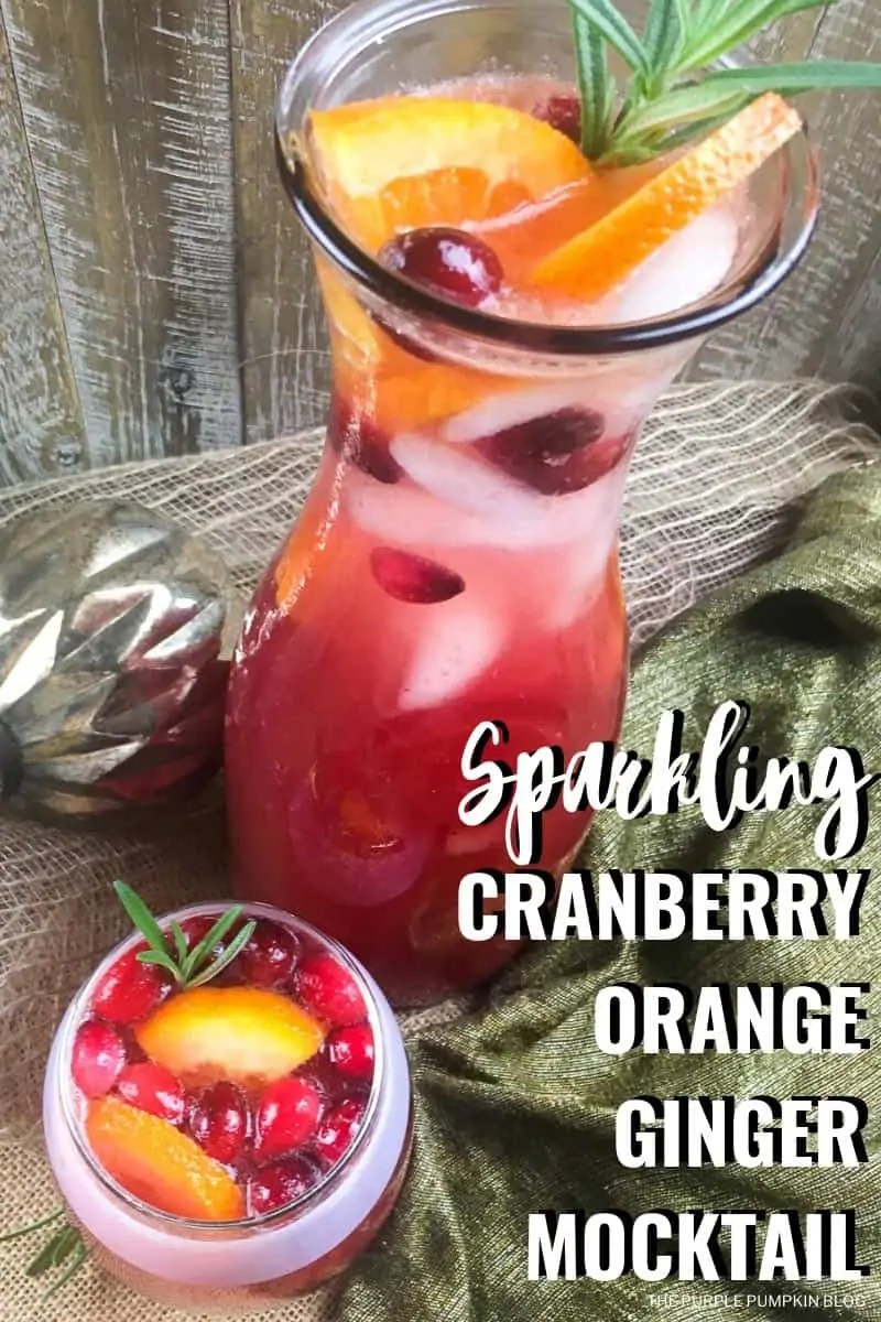 A carafe and glass filled with Sparkling cranberry orange ginger Christmas mocktail recipe