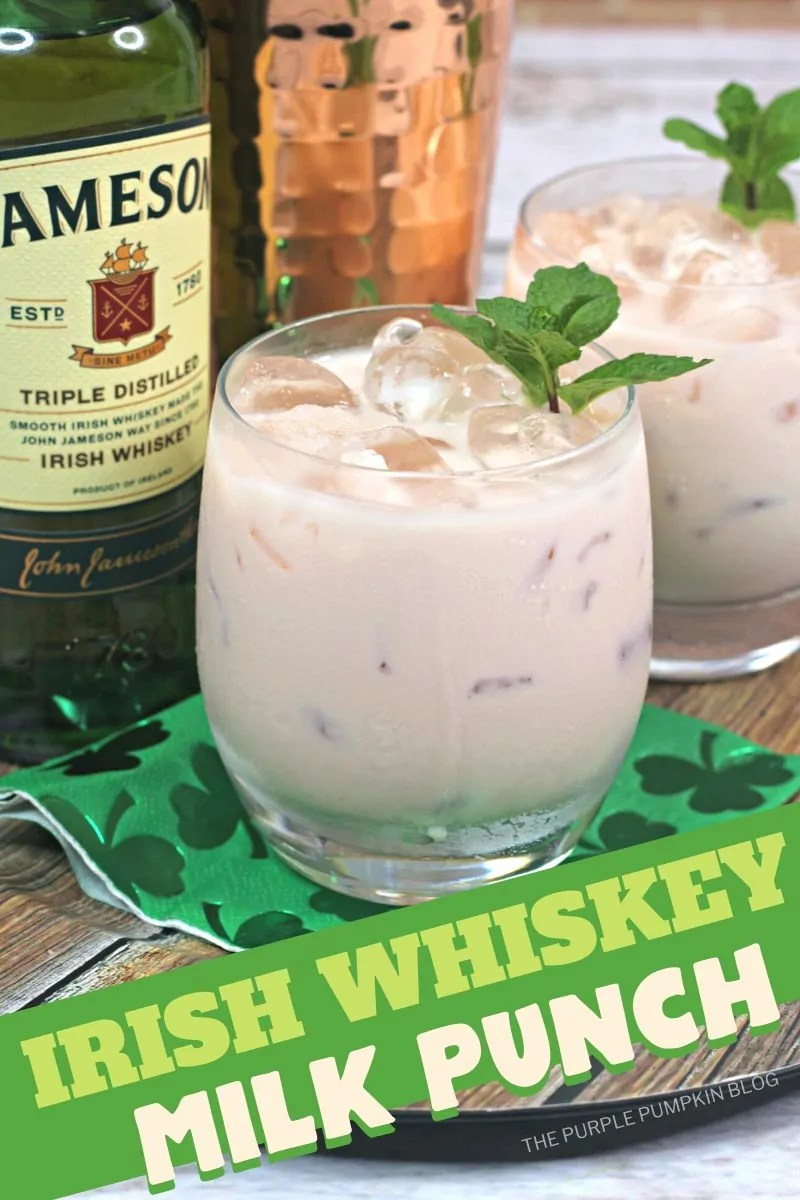 Irish Whiskey Milk Punch - two glasses of the creamy colored cocktail with a bottle of Jameson, and a cocktail shaker in the background.