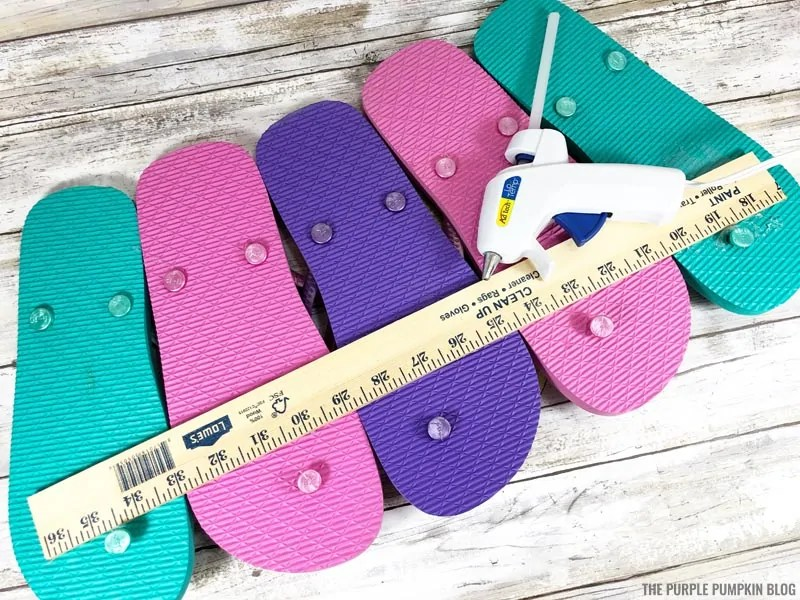 Attaching yard stick to back of flip flops