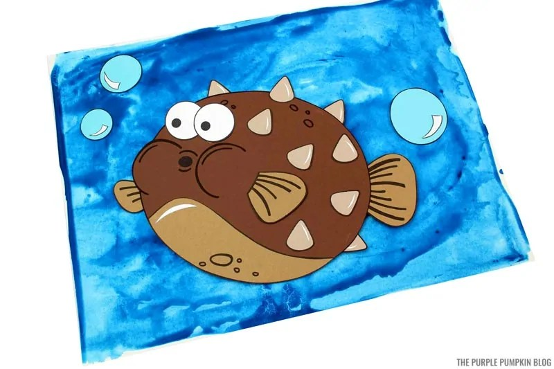 Pufferfish craft on blue painted background