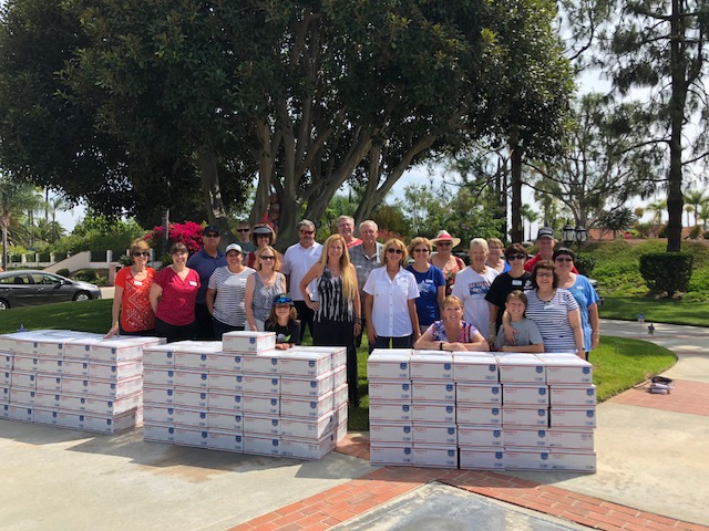 The volunteers who worked at the July packing day, with the completed boxes ready to go off to the post office!