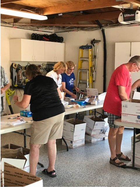A few of the volunteers of Operation America Cares, preparing the monthly boxes to be sent to our Military Heros who don't get recognized personally by family or friends.