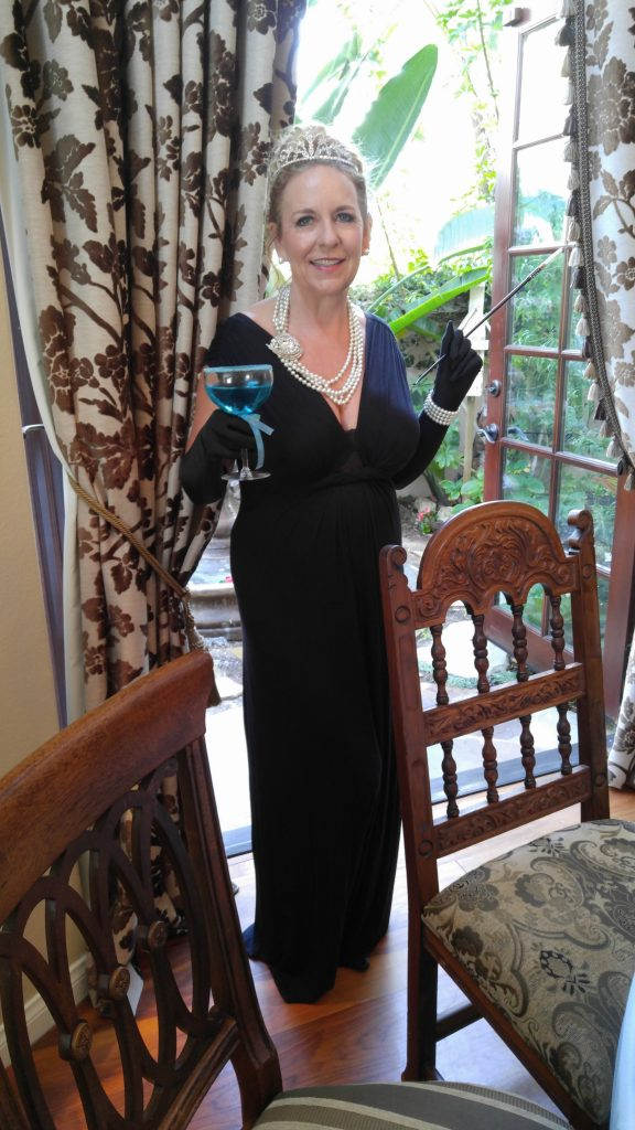"Patti - channeling her best ""Holly Golightly"" and holding one of the ""Tiffany Blue Mimosas!"