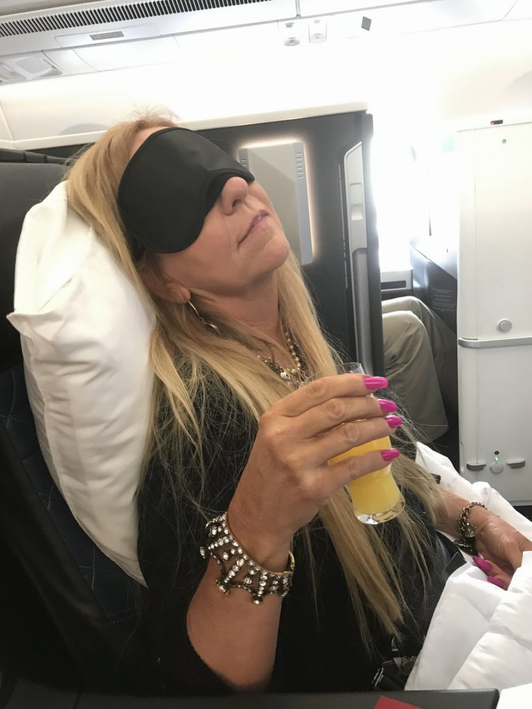 "There is a reason that First Class cost so much! Your own little ""pod"", Champagne or Mimosa in a real glass) before take off, a real pillow and a chair that turns into a bed.....Yep. A reason for First Class!"
