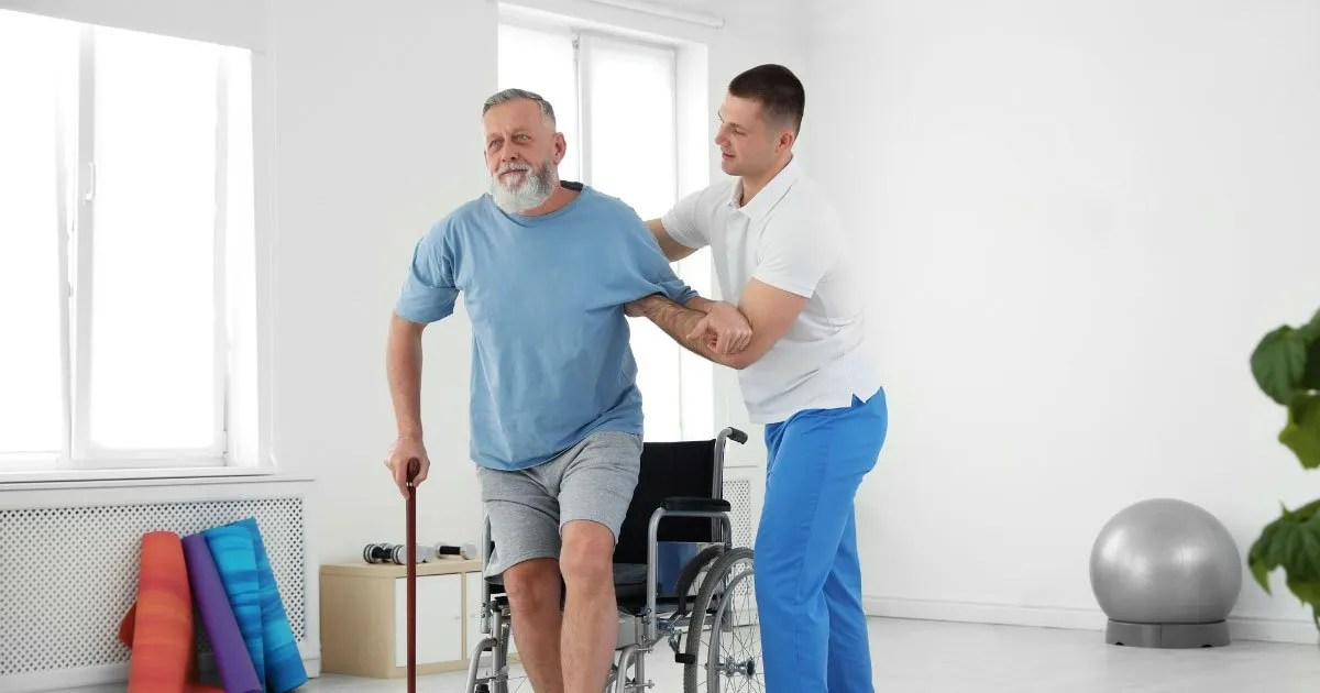 stroke-male-wheel-chair-cane-transition-therapist