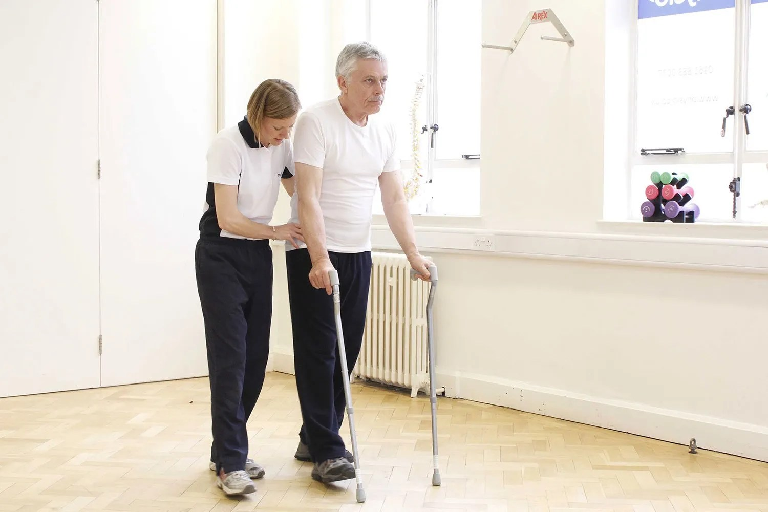 multiple sclerosis male two canes walking therapist