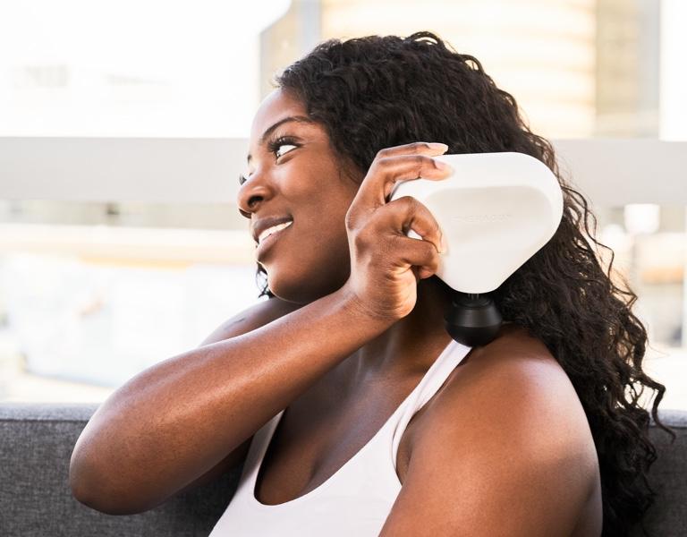 woman using device on train