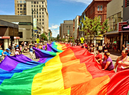 A 900-foot pride flag made and donated by Bishop from Merkaba Sol at last year's Pride Portland.  Photo: Steven Bridges  Main Feature Credit: Marilyn Humphries