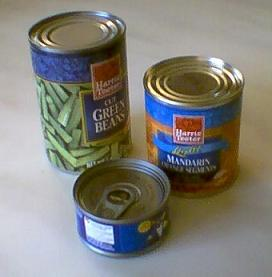 Three tin cans of varying sizes; the one at th...