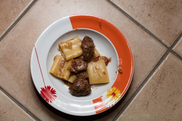 Paccheri pasta with Neapolitan ragù / ragù napolitano and meat slices.