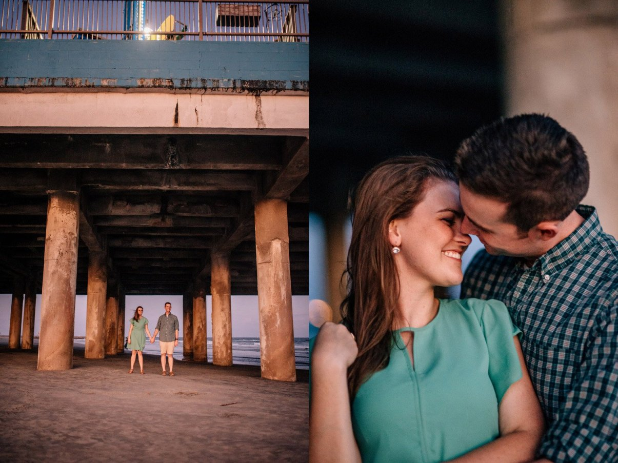 a couple underneath the pleasure pier during their intimate Galveston engagement pictures