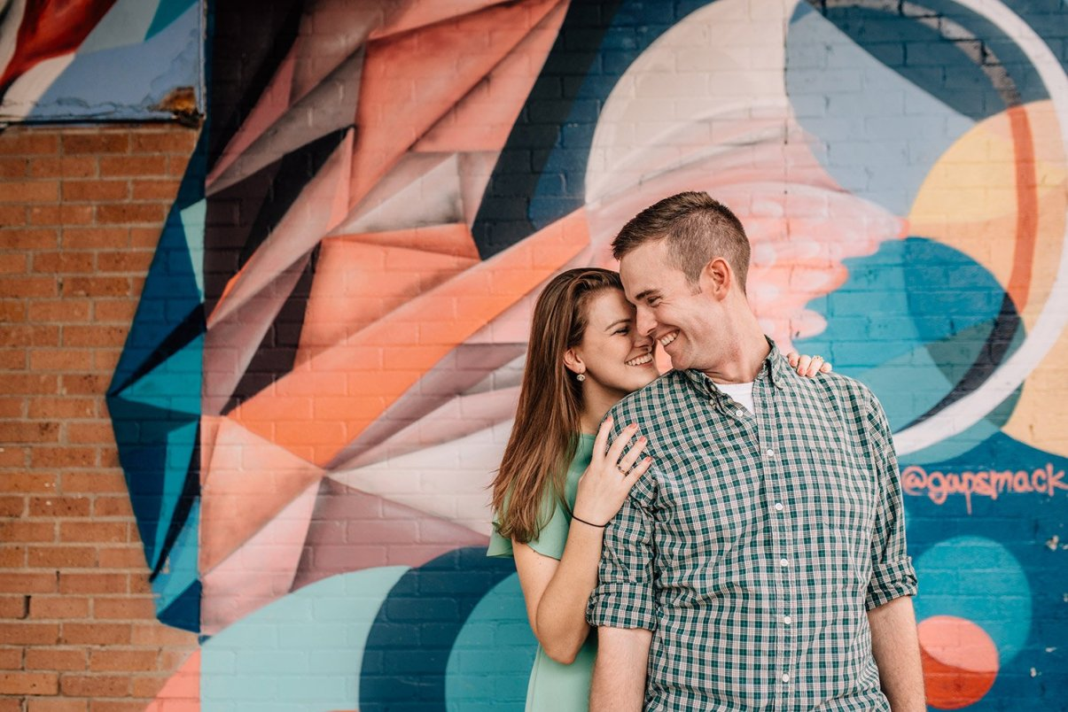A happy couple in front of a mural makes for great Galveston engagement pictures