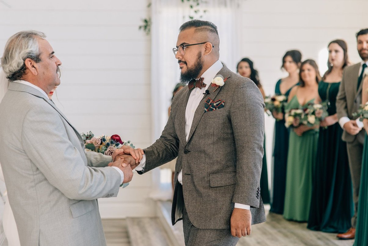 father of bride shaking grooms hand