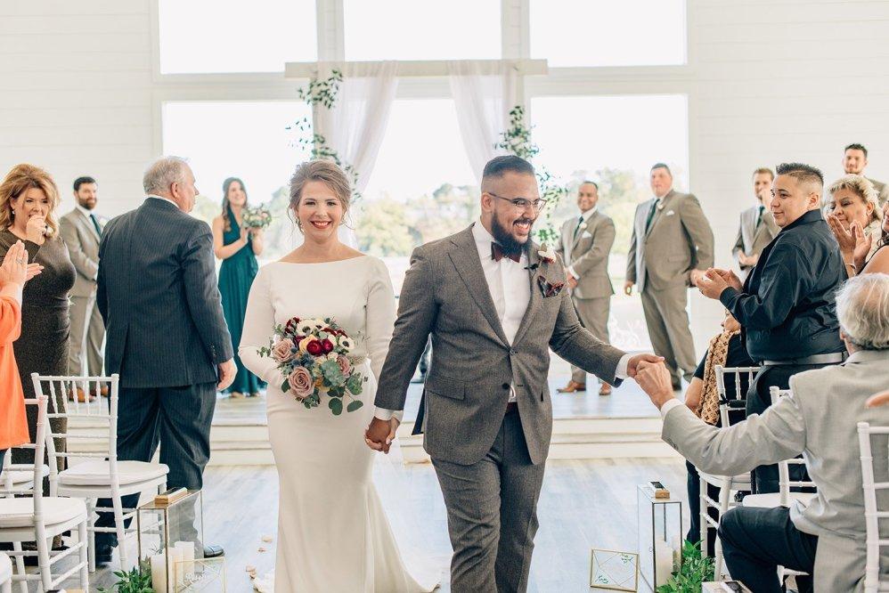 bride and groom exiting wedding ceremony