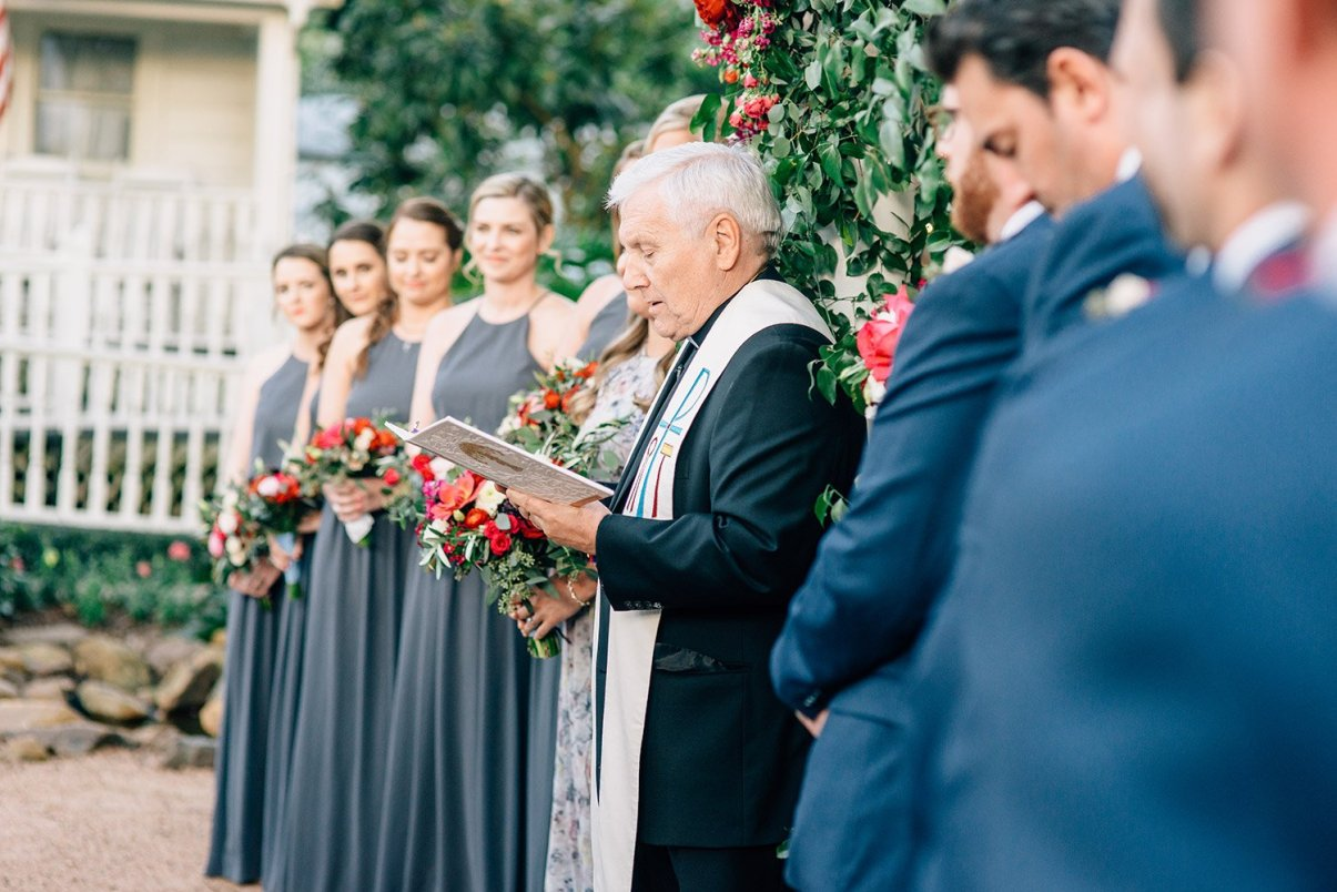 priest giving wedding homily