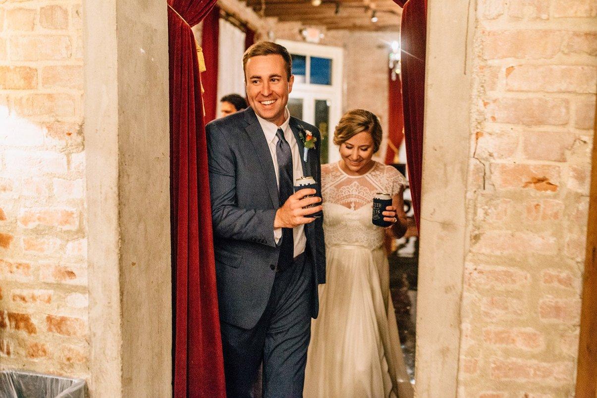 bride and groom entering their butler's courtyard wedding reception