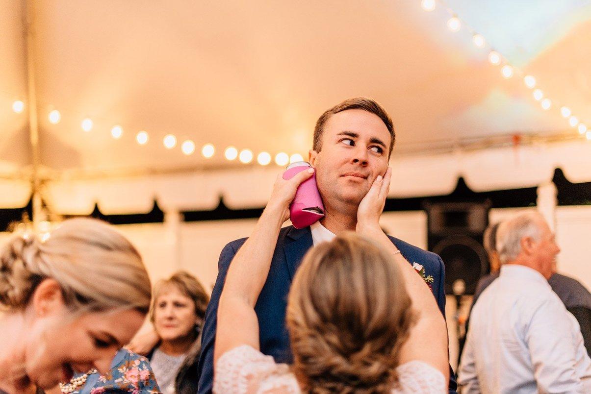 bride and groom goofing around