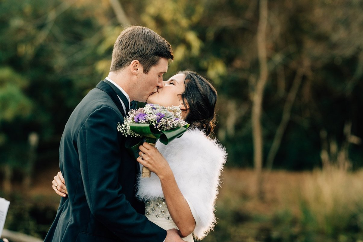 first kiss at Elopement at the Houston Arboretum