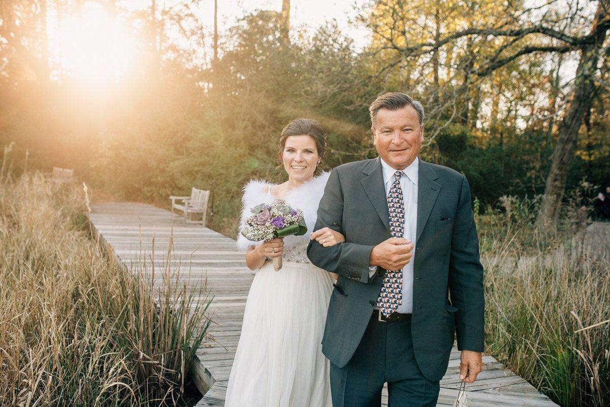 father of the bride walks in bride
