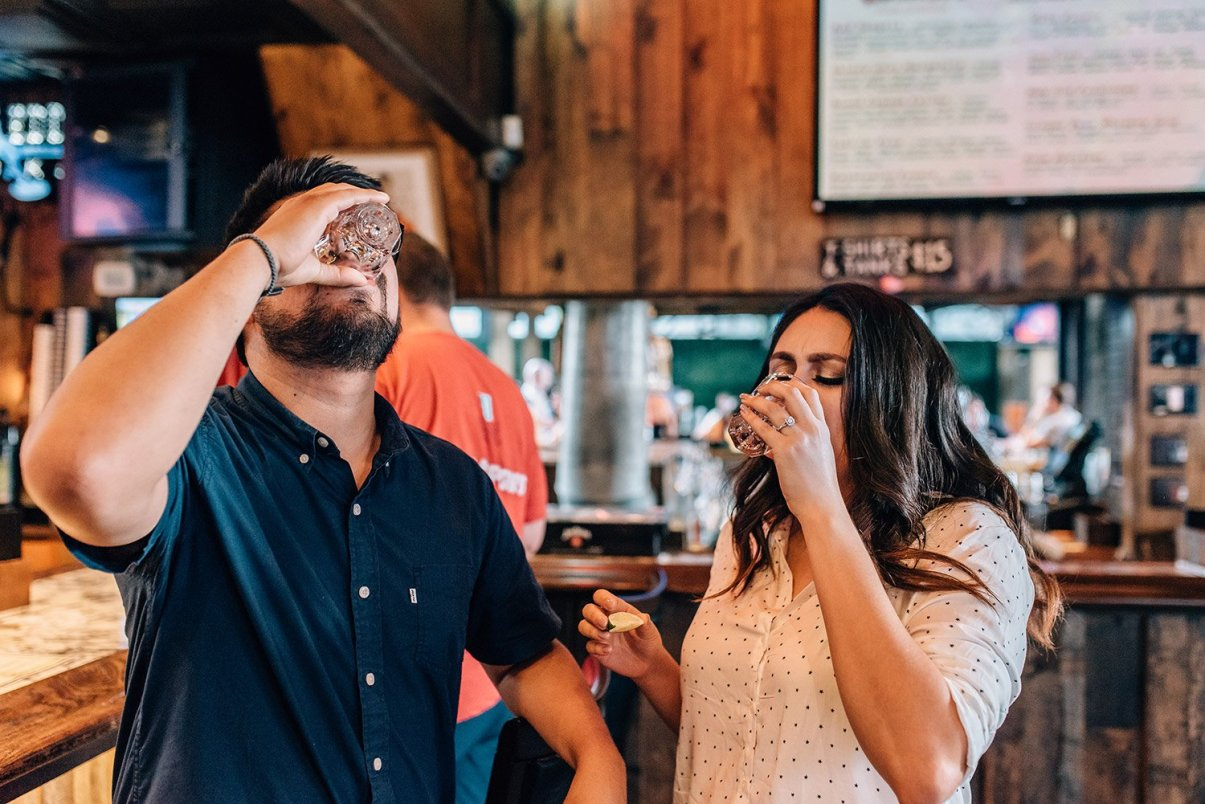 couple taking a shot of patron