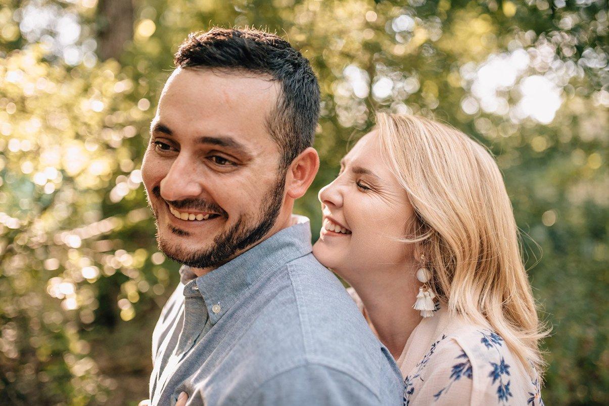 woman whispering in fiancé's ear