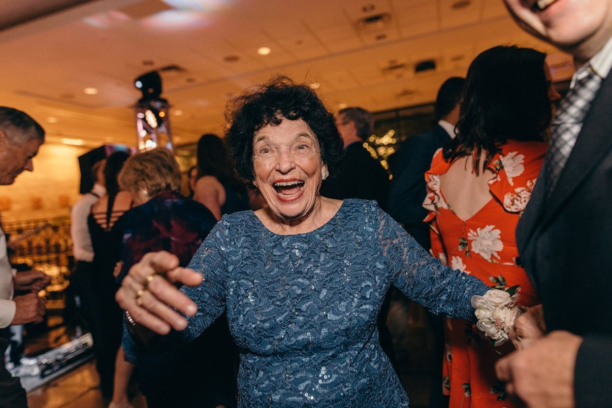 old lady having fun at wedding