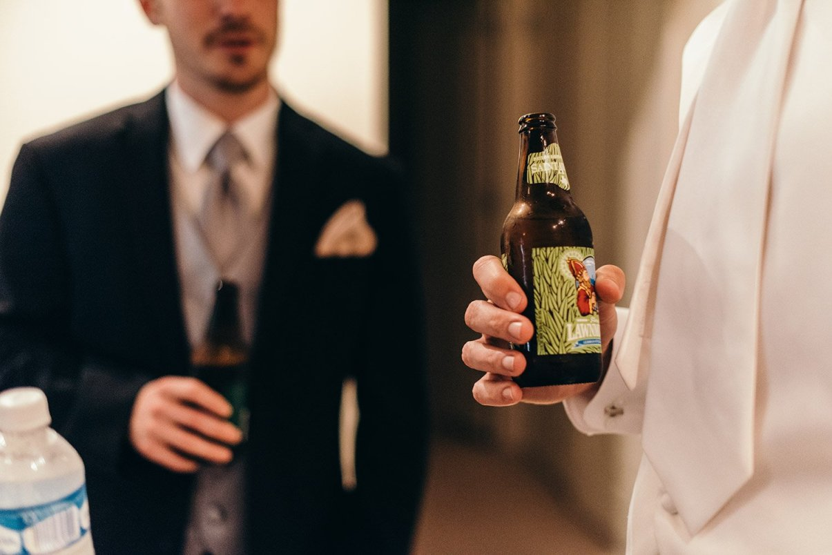 groomsmen drinking saint arnolds