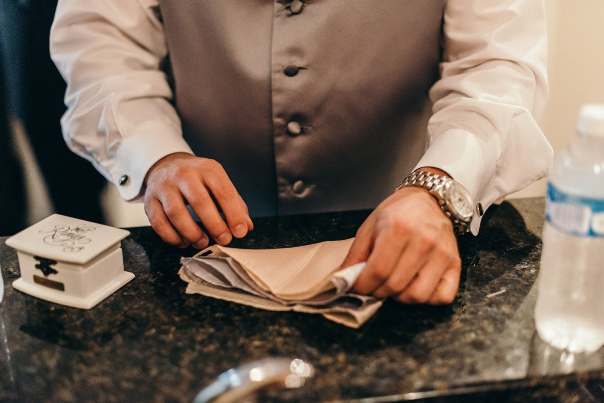 groomsmen folding pocket square