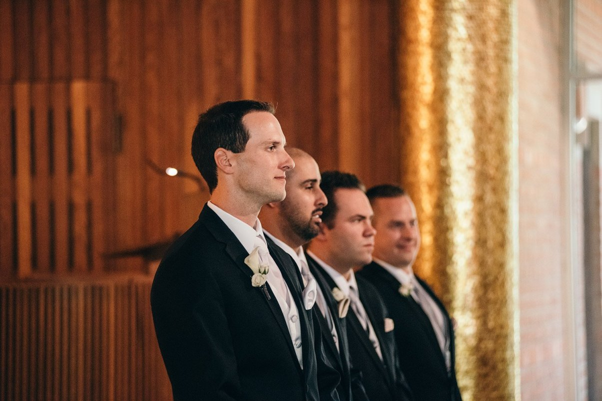 Groom seeing bride come down the aisle