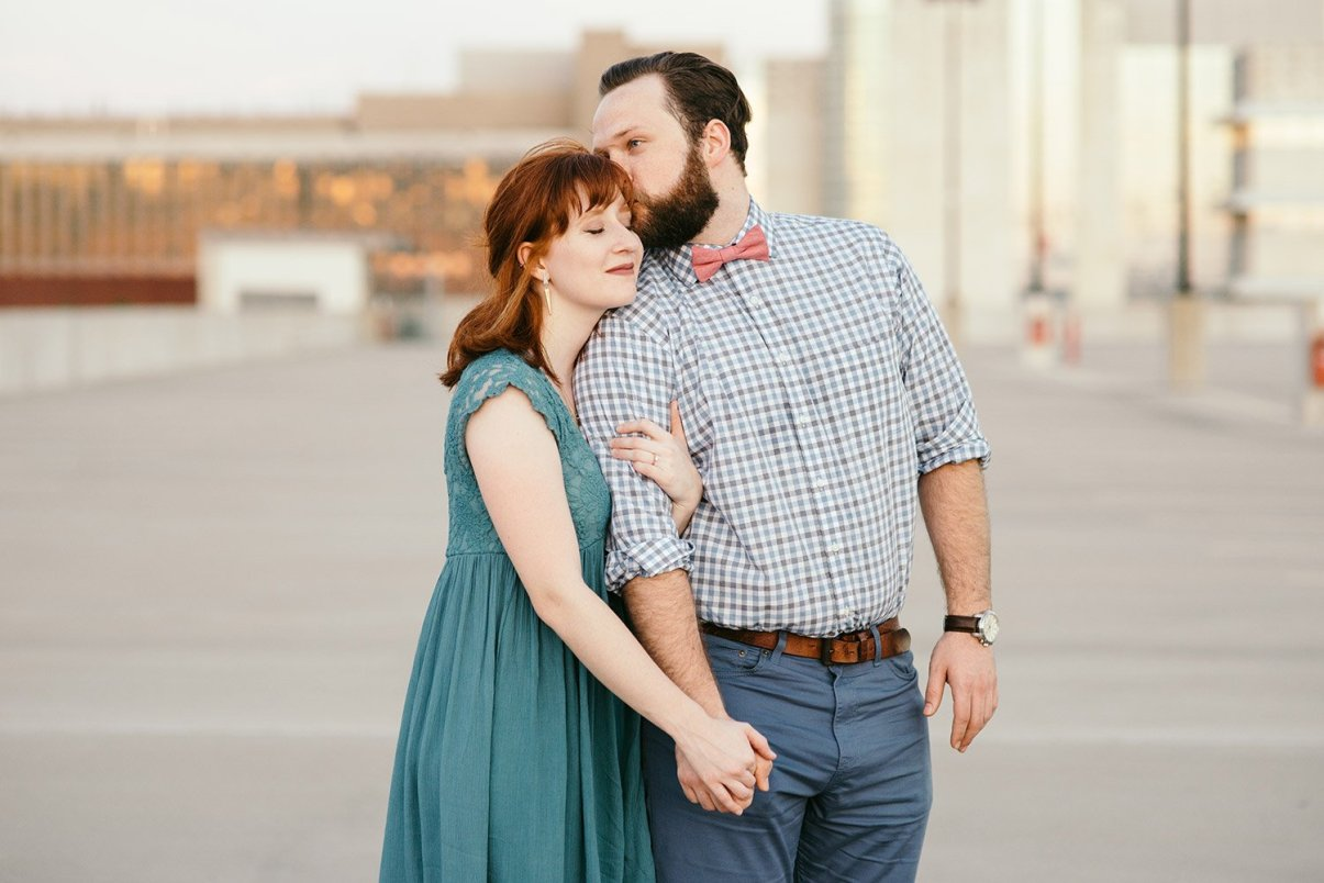 man kissing fiance on forehead