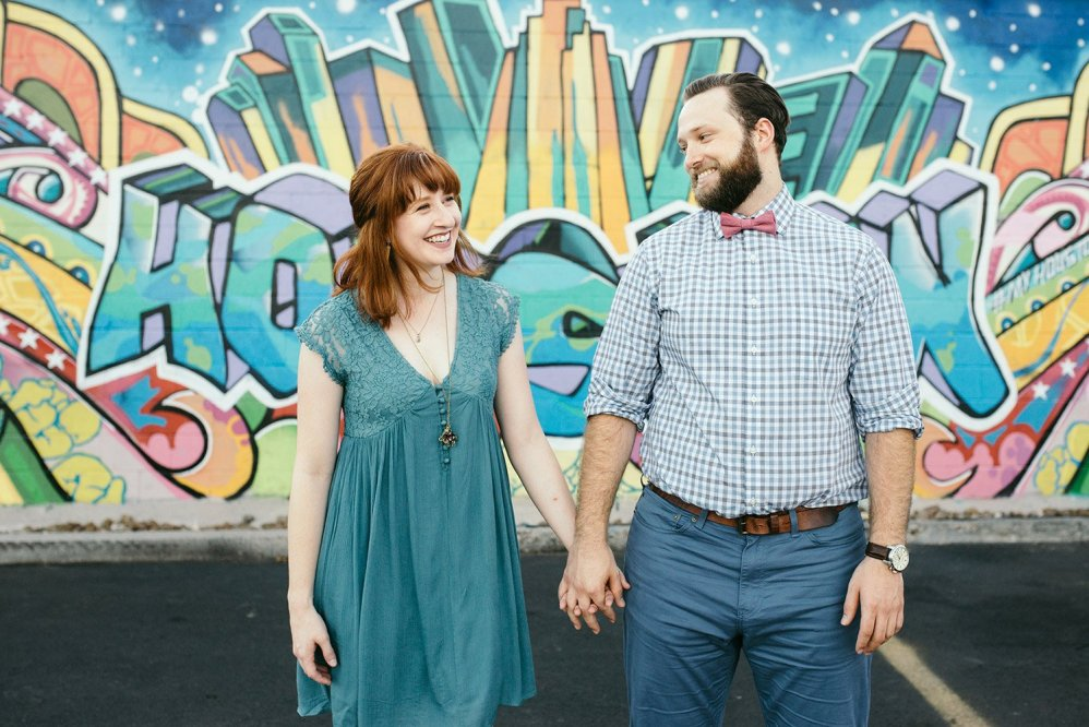 engaged couple in front of houston graffiti wall