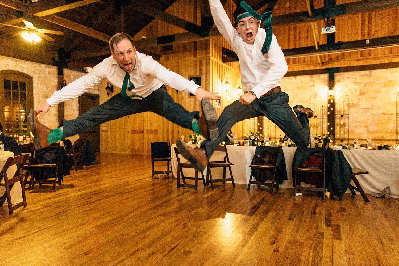 groomsmen jumping on dance floor