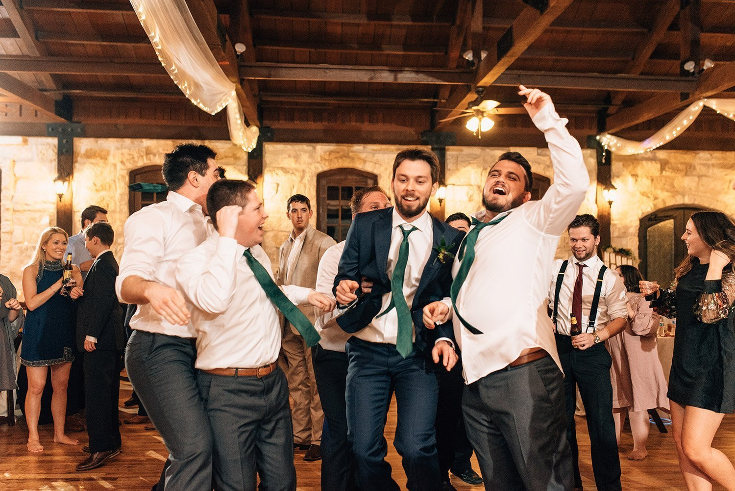 groomsmen dancing with groom at the springs event center