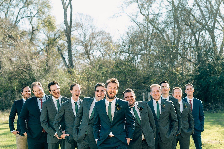 groomsmen goofing around with groom