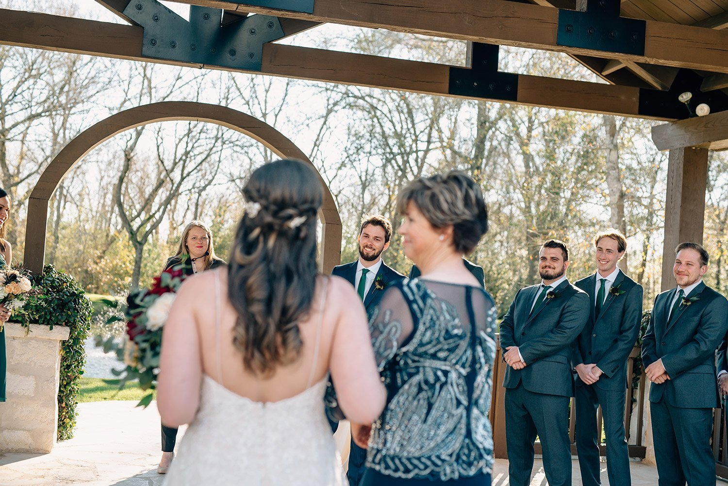 mother of the bride giving her away