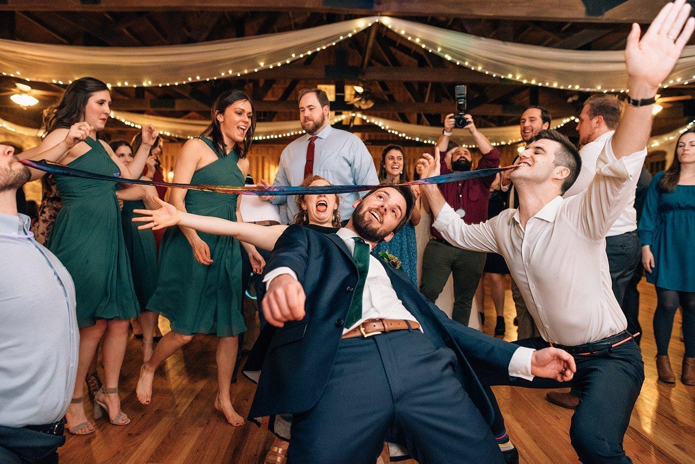 limbo on the dance floor at wedding reception