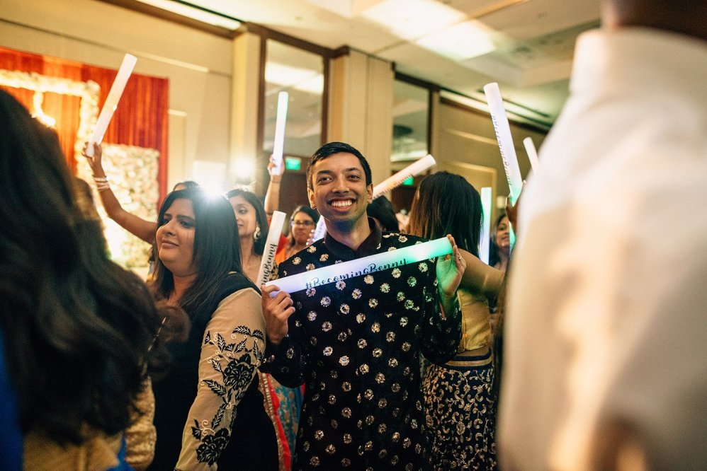 groom with light up stick at wedding