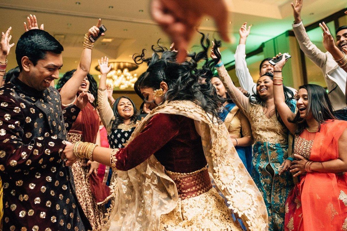 bride and groom dancing at Indian wedding