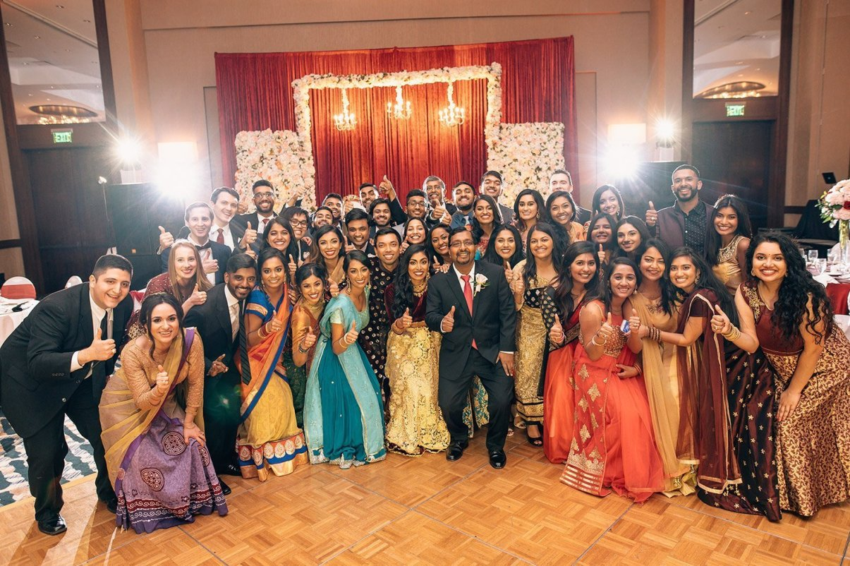Aggie group photo at woodlands resort wedding reception