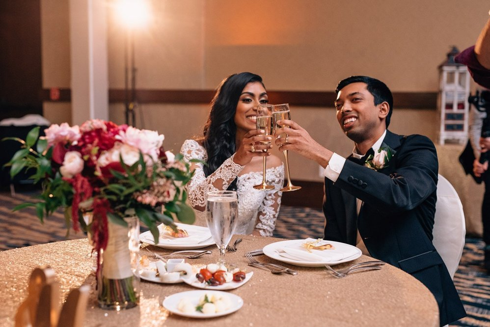 bride and groom toast at wedding reception