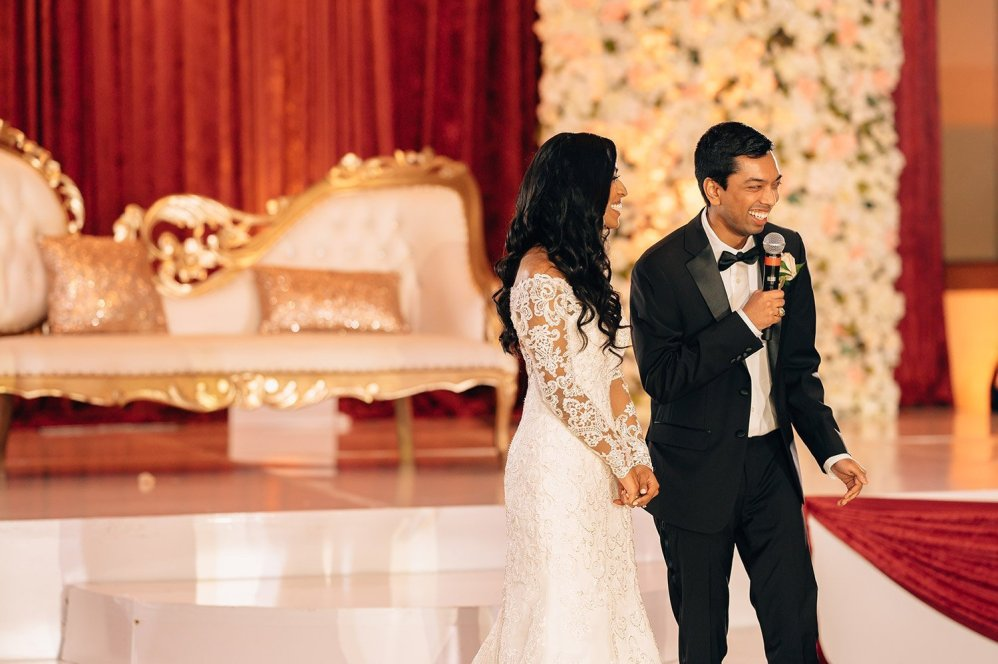 bride and groom welcome guests at woodlands resort wedding reception