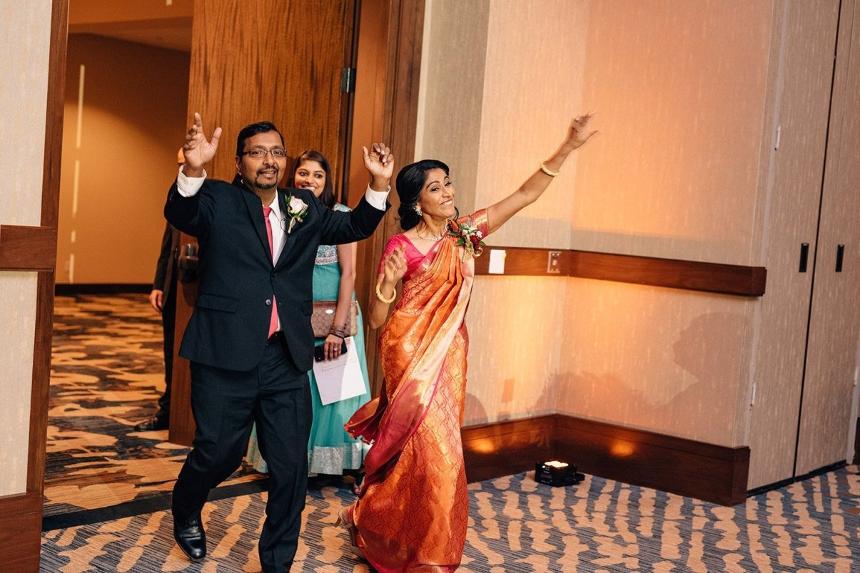 bride's parents enter wedding reception at the woodlands resort