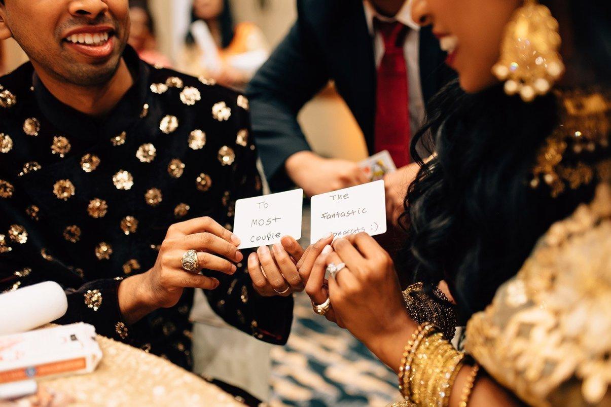 bride and groom enjoy a magic trick