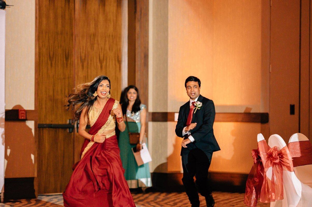 bridal party enters wedding reception