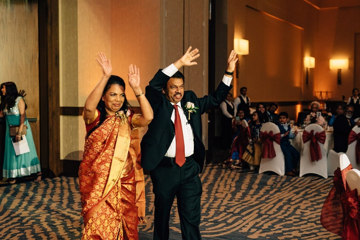 grooms parents entering wedding reception