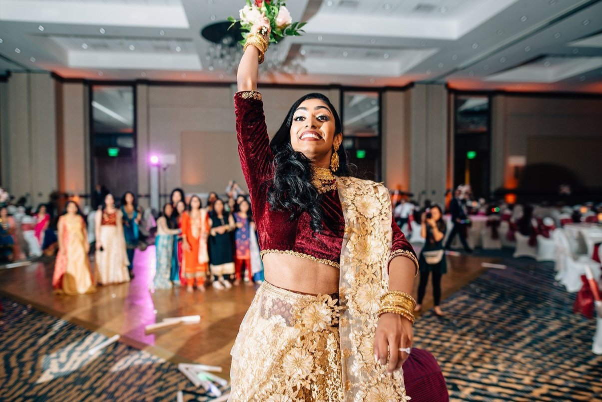 bouquet toss at woodlands resort wedding reception