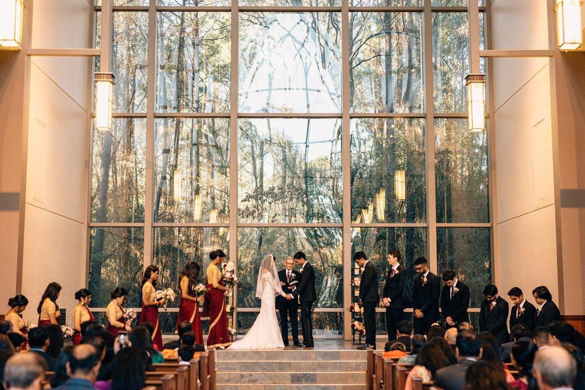 praying during wedding at chapel int hew oods